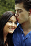 Kissing couple. Happy Kissing couple in garden Stock Photography