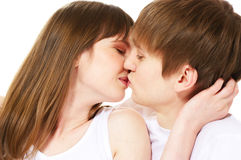 Kissing couple. Young loving kissing couple over white stock images