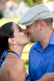A Kissing Couple. A young couple kissing each other on the lips Stock Photos