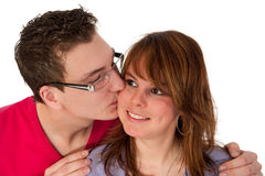 Kissing couple. In portrait in the studio stock photo