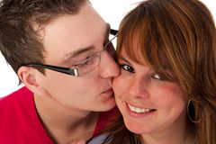 Kissing couple. In portrait in the studio royalty free stock image