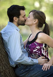 Kissing Couple. A young couple kissing in the park Stock Photos