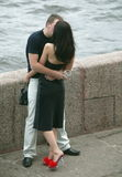 Kissing couple. On the bank of Neva river Royalty Free Stock Photo
