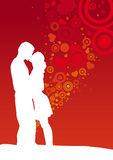 Kissing couple. On heart shaped red background Royalty Free Stock Image