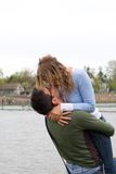 Kissing couple. Young man kisses and hugs girl Stock Photo