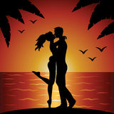Kissing couple. On beach on sunset Stock Photo