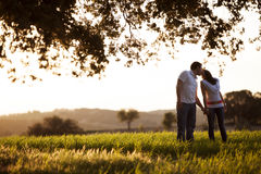 Kissing couple. Young kissing couple on idyllic background Royalty Free Stock Images