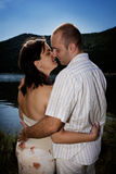 Kissing couple. Couple kissing by the lake - back light Royalty Free Stock Photo