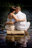 Kissing couple. Couple kissing on a log Stock Photo