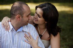 Kissing couple. Young couple flirting in nature Stock Photos