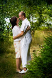 Kissing couple. Young couple kissing and flirting outdoors Stock Photography