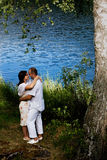 Kissing couple. Young couple flirting and kissing by the lake Royalty Free Stock Photography