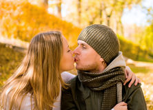 Kissing couple. In autumn park Stock Image