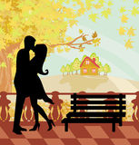 Kissing couple in autumn day Royalty Free Stock Image
