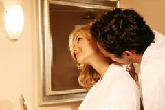 Kissing couple in bath Stock Images