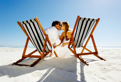 Kissing couple beach Stock Images