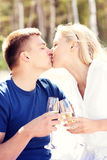 Kissing couple on the beach with champagne Royalty Free Stock Photos