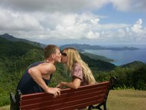 Kissing couple on bench Royalty Free Stock Photos