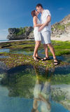 Kissing couple at blue beach Stock Image