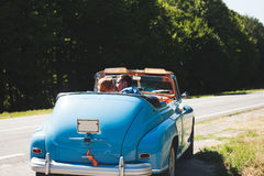Kissing Couple in Cabriolet. Kissing couple sitting in blue cabriolet Stock Photography