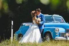Kissing Couple at Car. Kissing couple at old blue car Stock Photography