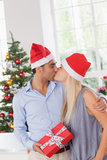 Kissing couple at christmas Stock Image