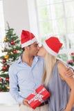 Kissing couple at christmas Stock Image