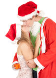 Kissing couple in a Christmas hats Stock Photography