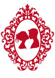 Kissing couple in frame Royalty Free Stock Photos