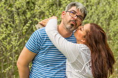 Kissing couple in front of forest Stock Photo