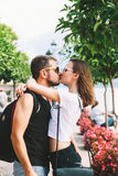 Kissing couple in Gargnano at Lake Garda, Italy, Europe. Happy tourist, young couple of lovers kissing at Lake Garda, Italy, Europe. Holidays and Travel Concept royalty free stock images