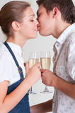 Kissing couple with glasses Royalty Free Stock Images