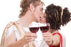 Kissing couple with glasses of wine Royalty Free Stock Images