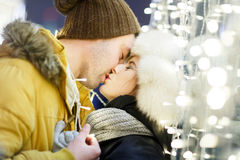 Kissing couple hugging background town Stock Photos
