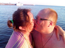 A kissing couple. Husband and wife are kissing enjoying summer vacation Stock Photos
