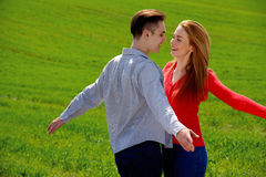 Kissing couple in love. They are smiling and looking at each otherh Royalty Free Stock Image