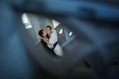 Kissing couple in love standing on a ladder Royalty Free Stock Photo