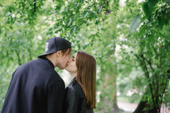 Kissing couple in the middle of the park royalty free stock image