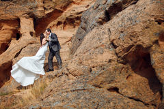 Kissing couple in the mountains Stock Photos