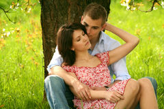 Kissing couple in nature Stock Image