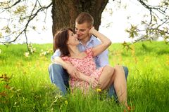 Kissing couple in nature Stock Images