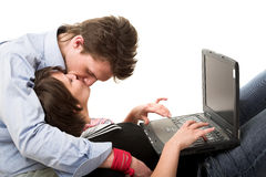 Kissing couple and notebook. Kissing young couple and notebook isolated on white Stock Photo