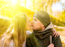 Kissing couple in park. Kissing couple in autumn park Royalty Free Stock Photography