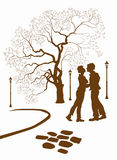 Kissing couple in the park . Vector Stock Images