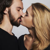 Kissing couple portrait.romantic beautiful woman and handsome man Royalty Free Stock Photography
