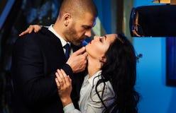 Kissing couple. Portrait of a sensual brunette and handsome businessman. Office romance concept Stock Photo