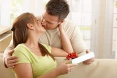 Kissing couple with present Stock Photography