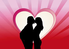Kissing couple in a red heart Royalty Free Stock Images