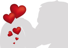 Kissing couple with red hearts Royalty Free Stock Image