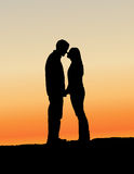 Kissing Couple Silhouette Stock Images